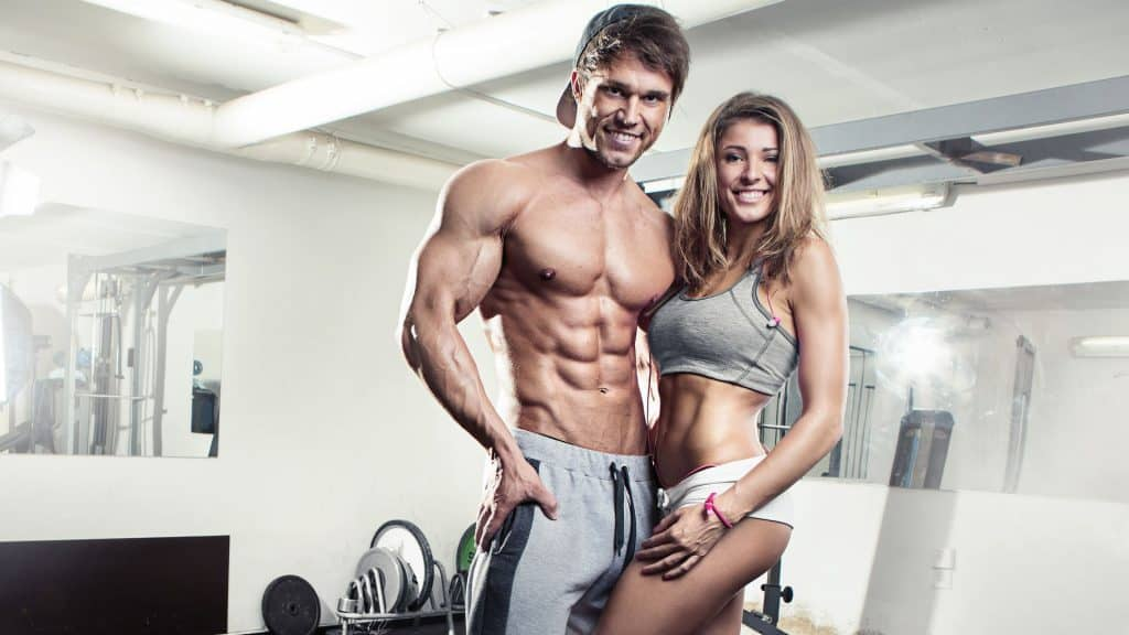 Sporty fit couple at the gym